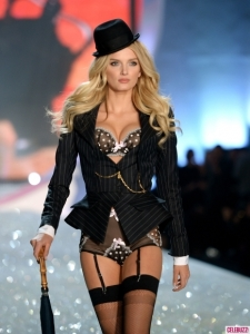 "Lily Donaldson rocks the garter belt standing at 5'10"" and 26 years old."
