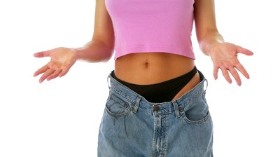 stock-footage-woman-showing-off-weight-loss-in-baggy-jeans